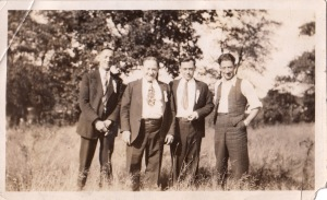 Hyman (second from left) and Joe (far right) and two unknown men