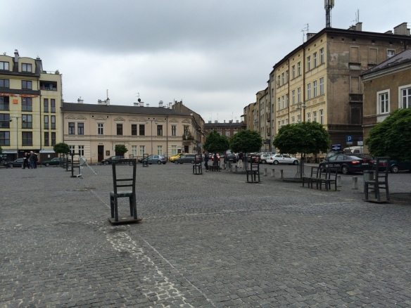 The ghetto in Podgorze.  The empty chairs evoke the chairs that were left behind by those who had been sitting while awaiting the transports that took them to the camps