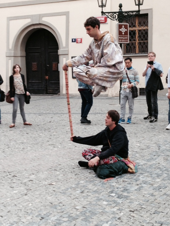 Street performers---can anyone tell me how they do this??