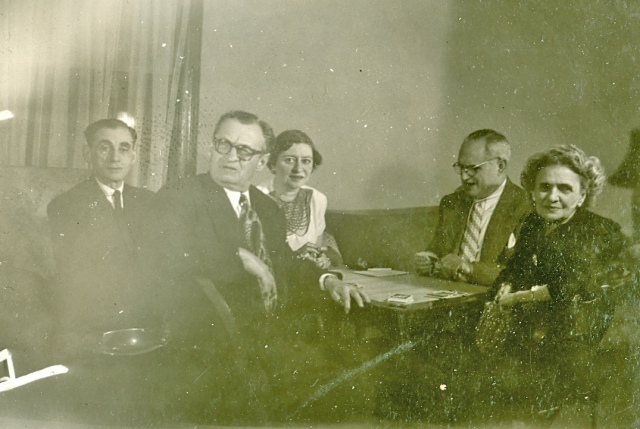Max (front left), Leo (rear on right), and Mary (front right) and two friends playing cards  Courtesy of Steve Seligman