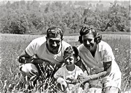 Mom and Dad with Robert in the grass